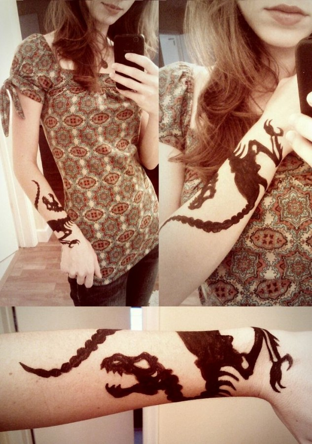 Amaizing woman dinosaur tattoo