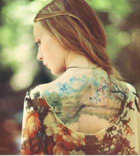 Amazing girl painting tattoo