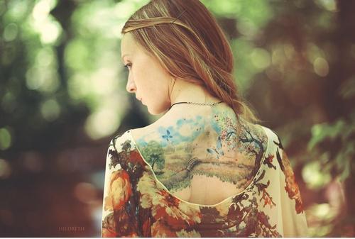 Amazing girl painting tattoo