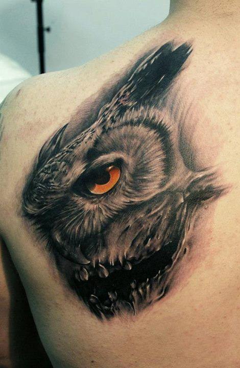 Amazing red owl tattoo