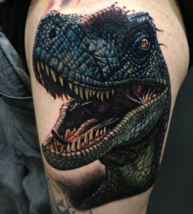 Angry dinosaur tattoo