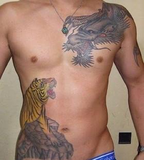 Angry lion and dragon tattoo