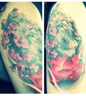 Animal and pink lotus flower tattoo