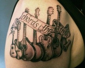 Awesome black guitar tattoo