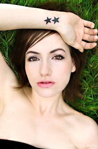 Beautiful woman star tattoo