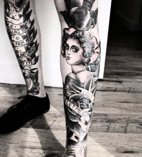 Bird and woman legs tattoo