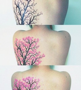 Black and pink tree tattoo