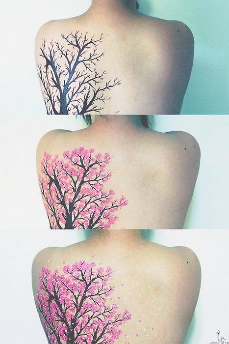 Black and pink tree tattoo