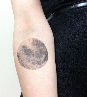 Black and white moon tattoo