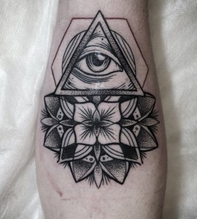 Black and white origami eye tattoo