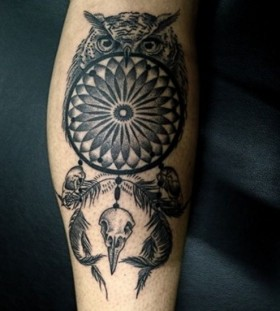 Black angry owl tattoo
