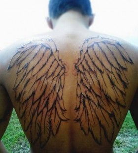 Black back wings tattoo