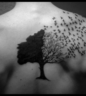 Black birds and tree tattoo