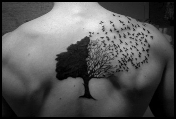 Black birds and tree tattoo