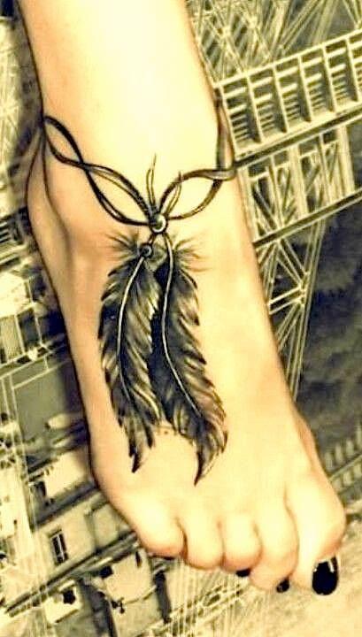 Black feather foot tattoo