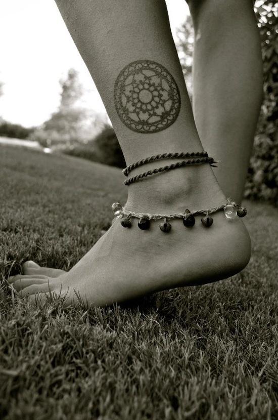 Black foot tattoo
