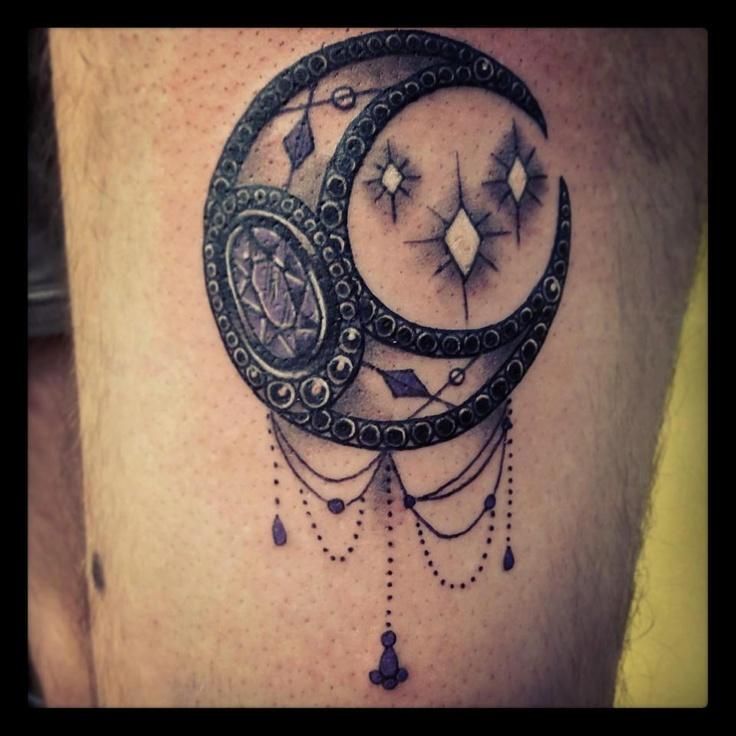 Black moon tattoo