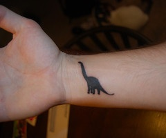 Black small dinosaur tattoo