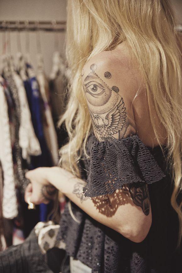 Blond girl eye tattoo