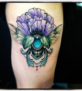 Blue and purple insect tattoo