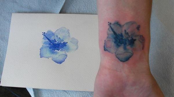 Blue flower painting tattoo