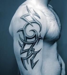 Blue shoulder tribal tattoo