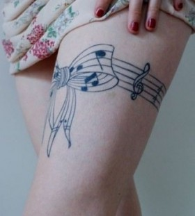 Bow and music legs tattoo