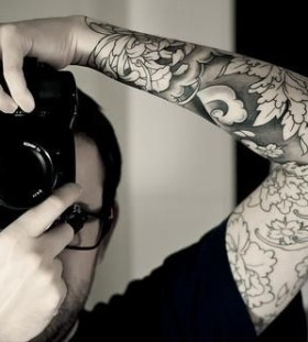 Camera and dragon tattoo