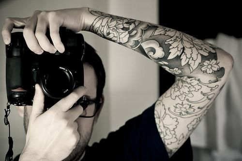 Camera and dragon tattoo