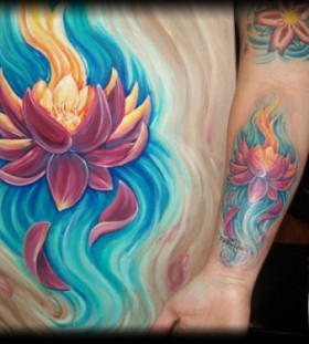 Colorful blue and yellow lotus flower tattoo