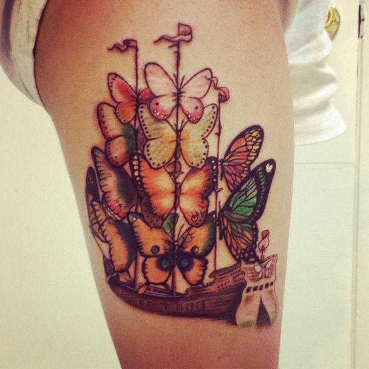Colorful butterflies and ship tattoo