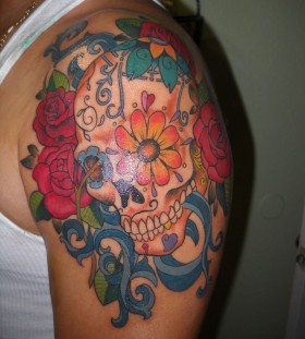 Colorful flowers skull tattoo