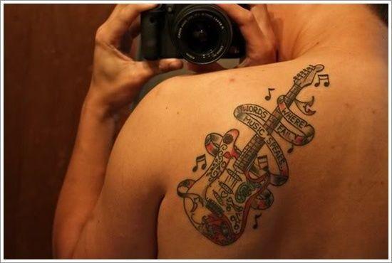 Colorful shoulder guitar tattoo