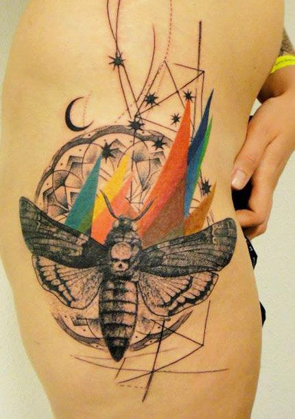 Colorful skull and insect tattoo