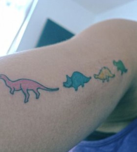 Colorful small dinosaur tattoo