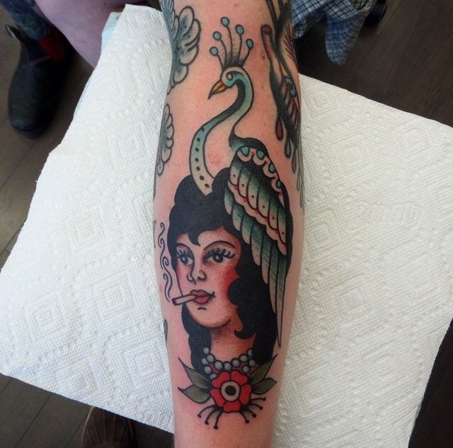 Colorful woman tattoo by Dustin Barnhart