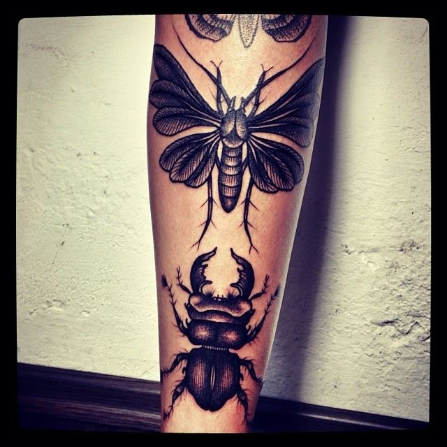 Cool insects tattoo made by Berlin artist