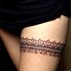 Crown on leg lace tattoo