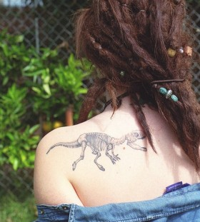 Dinosaur bones tattoo