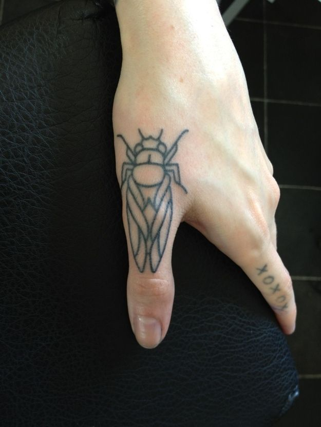 Finger insect tattoo