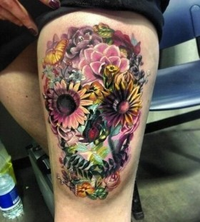 Flowers and butterfly skull tattoo