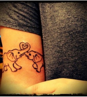 Funny elephants girl tattoo