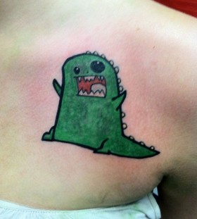 Funny green dinosaur tattoo
