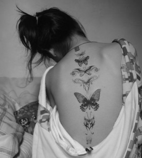 Girl back butterfly tattoo