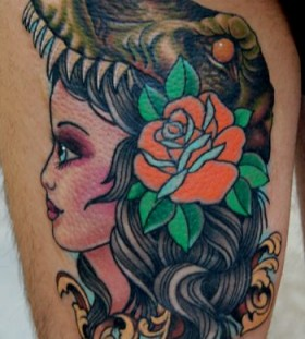 Girl red rose and dinosaur tattoo