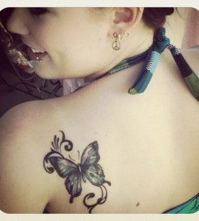 Girl shoulder butterfly tattoo