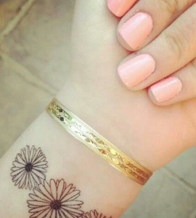 Girls wrist sunflower tattoo