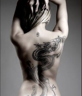 Gorgeous woman dragon tattoo