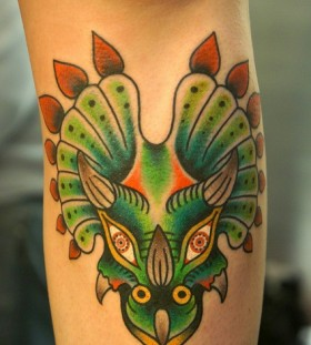 Green dinosaur tattoo