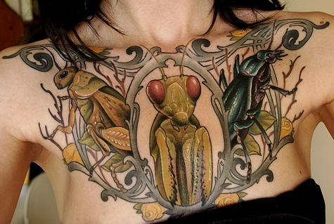 Green insect tattoo